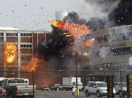 Brachs Candy building,left, and parking building, made to look like, Gother General Hospital, implode at the corner of Cicero Avnue and Ferdinand Street during the filming of the Batman movie \