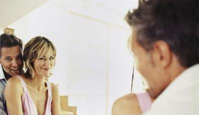 Couple Embracing in Front of Mirror --- Image by © Martin Meyer/zefa/Corbis