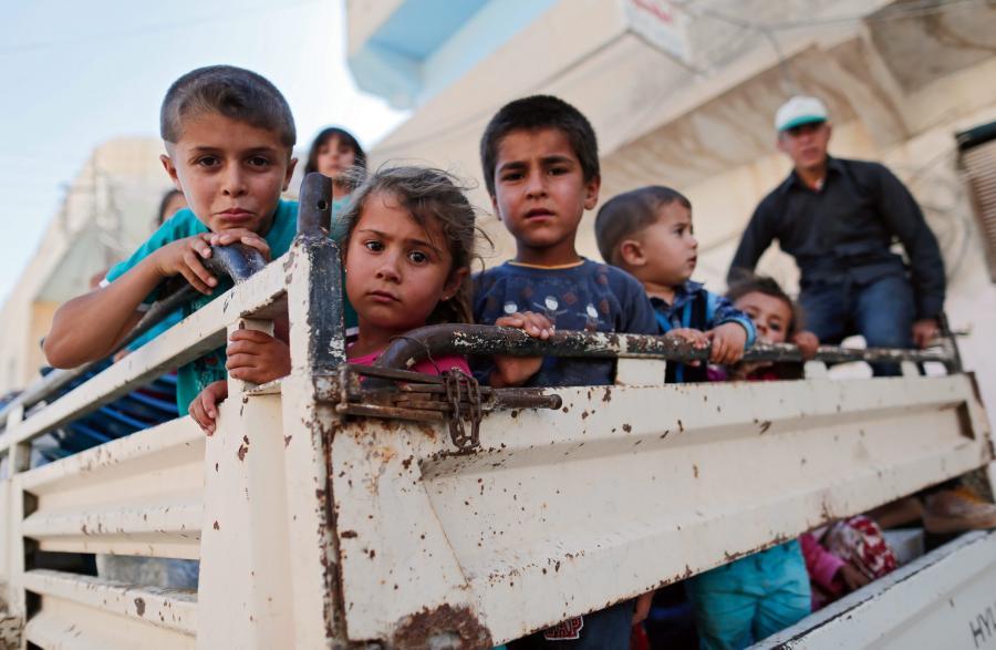 Syryjcycy uciekają z Kobane